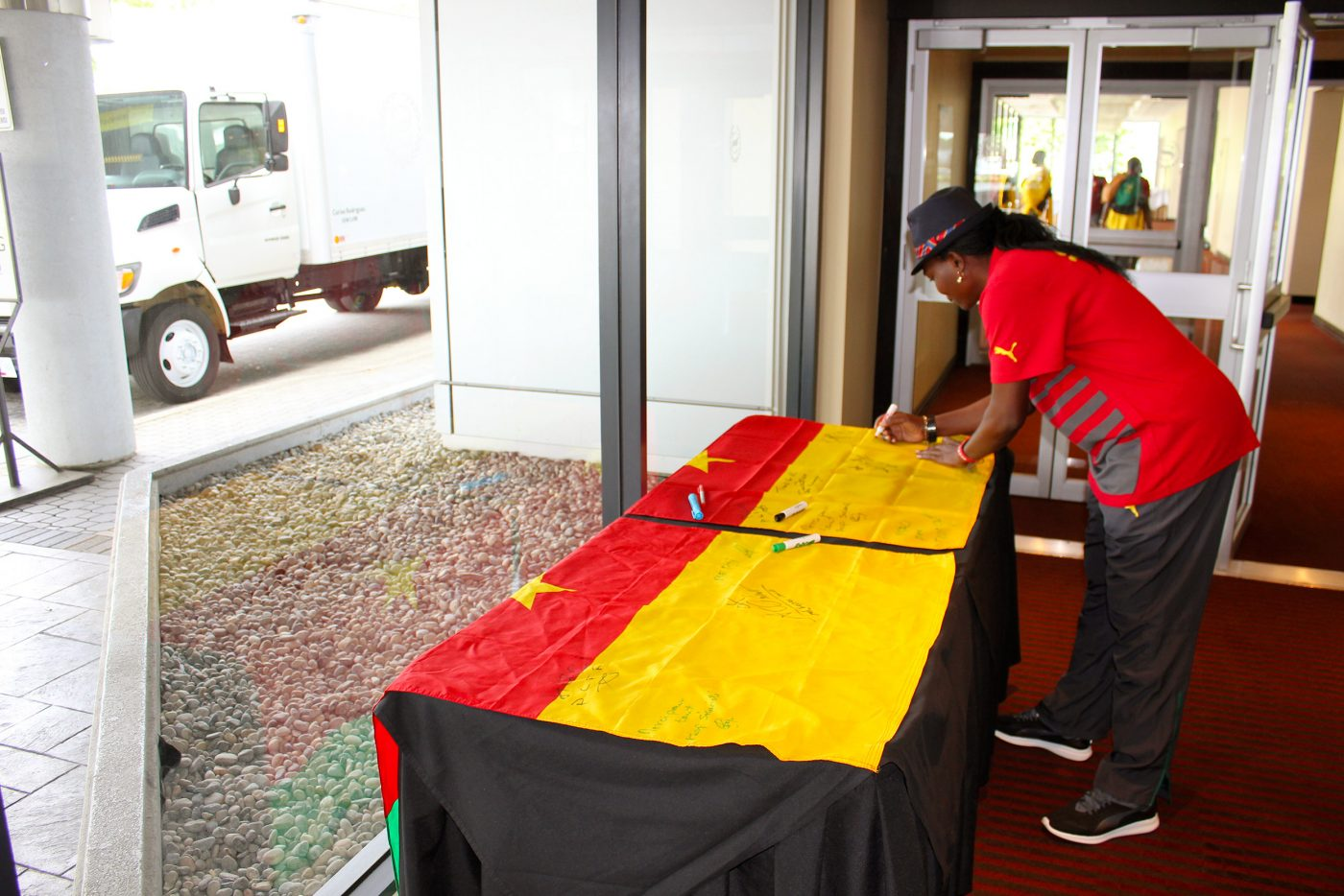 Signing the Cameroon Flag